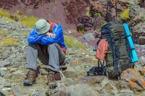 Trekker resting in height mountain